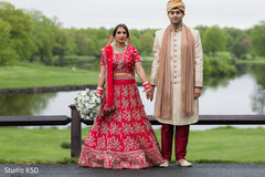 Glamorous Indian couple posing outdoors.