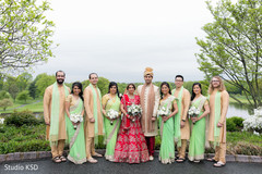 Adorable Indian bride and groom with bridesmaids and groomsmen.