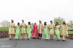Ravishing Indian couple with bridesmaids and groomsmen photo session.