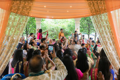 Indian wedding guest at the baraat celebration capture.