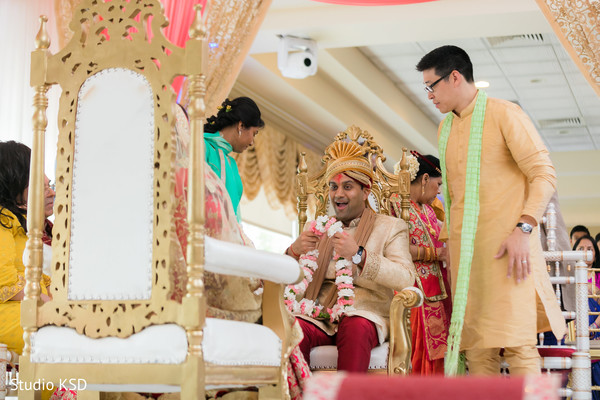 Indian groom about to put bride the garland.