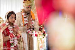Indian lovebirds at ceremony praying moment.