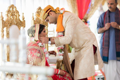 Indian groom putting chain to bride.