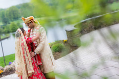Adorable Indian bride and groom face to face out door portrait.
