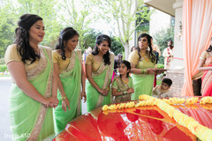 Indian bridesmaids waiting for Indian couple out side ceremony.
