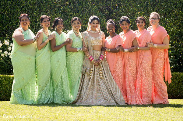 Indian bride posing with beautiful bridesmaids