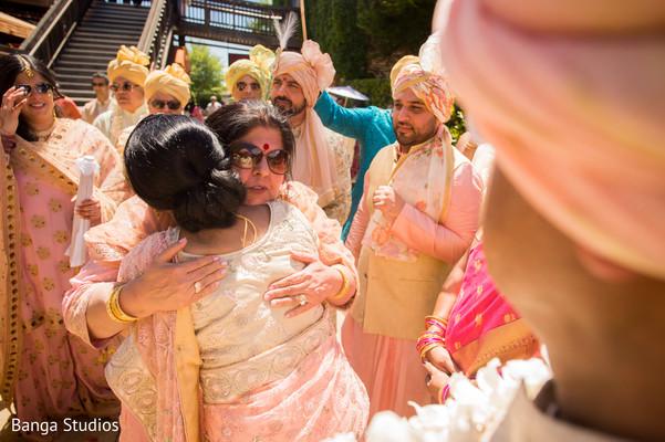 Indian bride and groom's relatives at milni celebration.