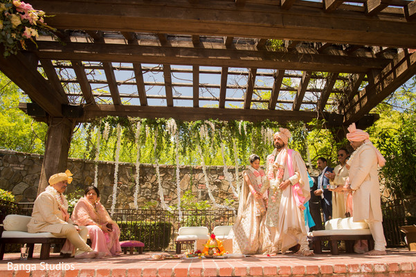 Indian couple walking around sacred fire ritual.