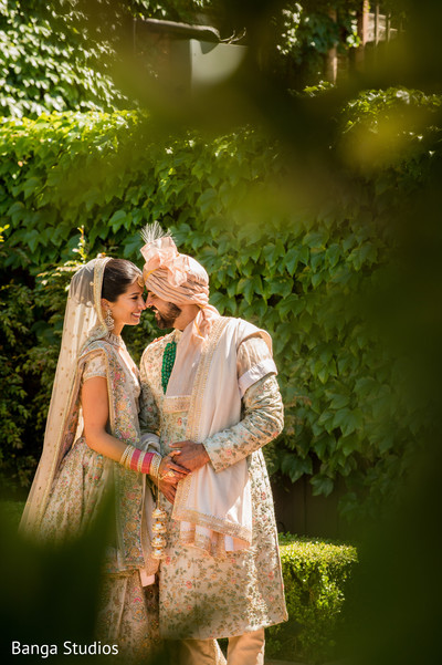 indian bride and groom looking at each other capture.