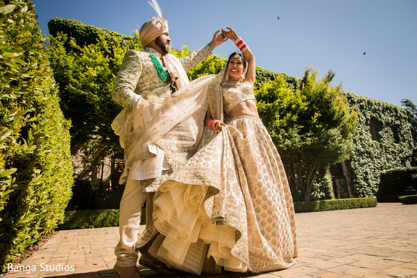 Indian bride and groom on their wedding ceremony outfits.