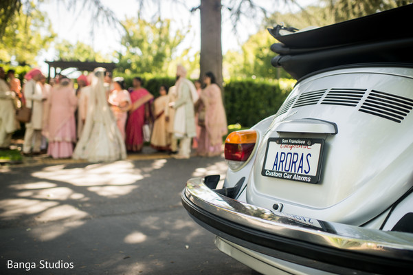 Indian wedding vehicle with personalized plate.