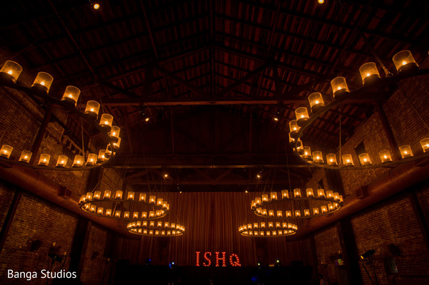 Indian wedding reception candles chandeliers.
