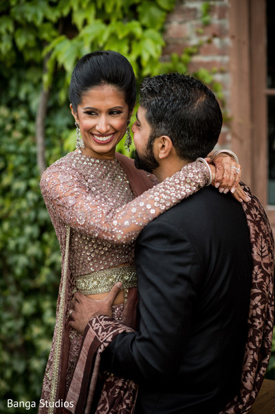 Indian bride and groom posing for reception photo shoot.