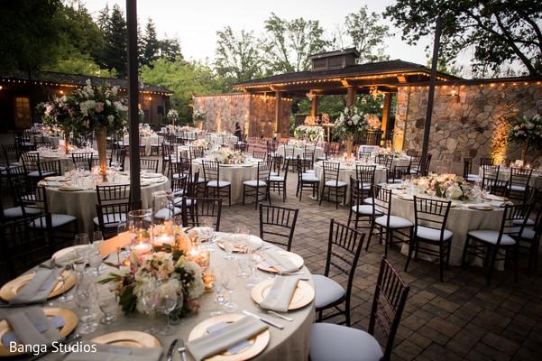 Indian wedding outdoors reception table setup.