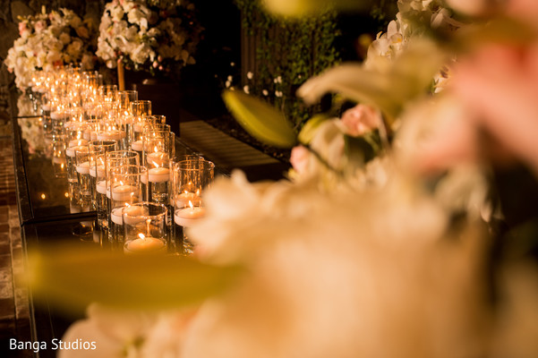 Indian wedding reception stage ivory candles decoration.