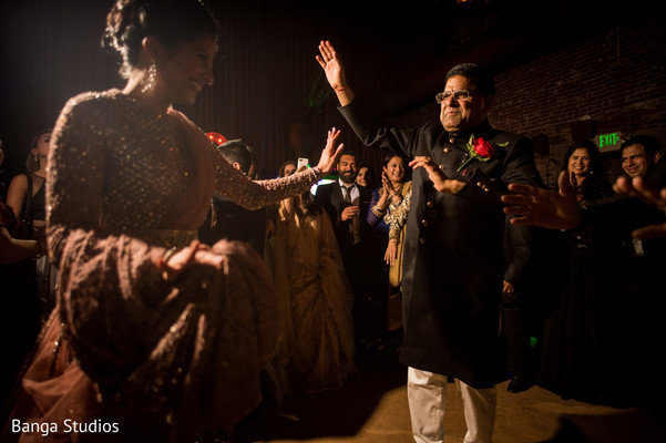 Indian bride and father at reception party celebration.