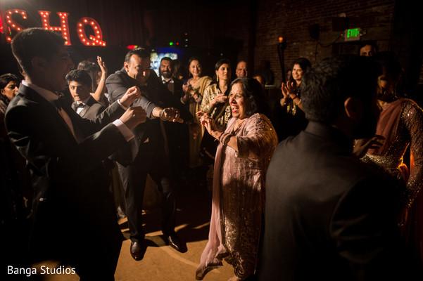 Upbeat indian wedding reception dance photo.