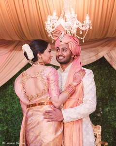 Enchanting Indian couple posing for photo shoot.