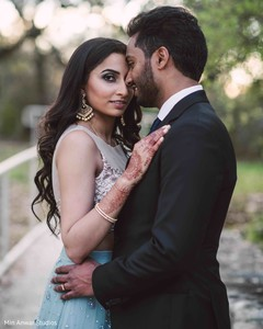 Elegant Indian bride and groom's reception look.