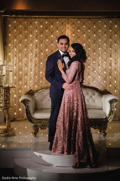 Elegant Indian couple on their reception outfits.