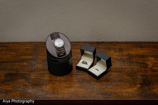 Elegant Indian groom's watch and wedding rings.
