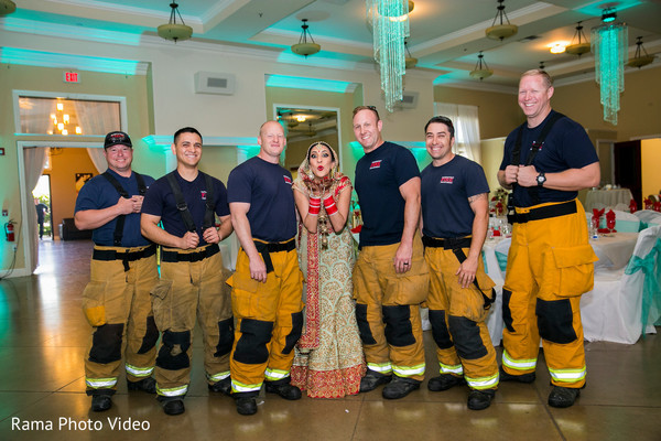 Maharani posing with firefighters