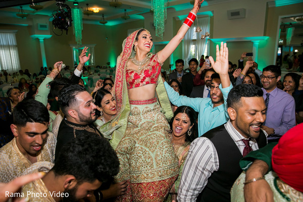 Indian bride being carried by guests