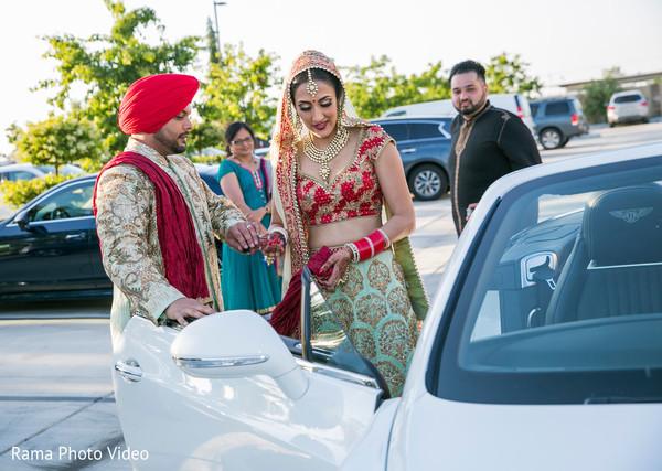 Indian bride getting in their vidaai car