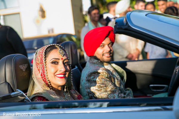 Lovely indian couple exiting their ceremony