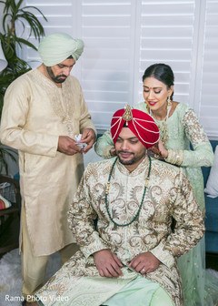 Charming indian groom getting ready