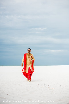 Indian groom walking outdoors for pictures