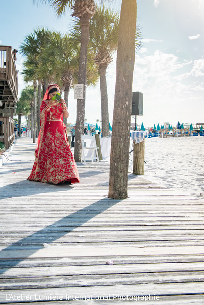 Indian bride walking at the pier