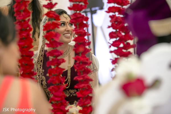 See this joyful Indian bride at her wedding ceremony.