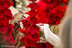 Indian bride and groom holding hands ritual.