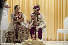 Joyful Indian couple at wedding ritual capture.