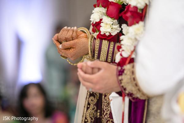 Closeup capture of Indian couples hands.