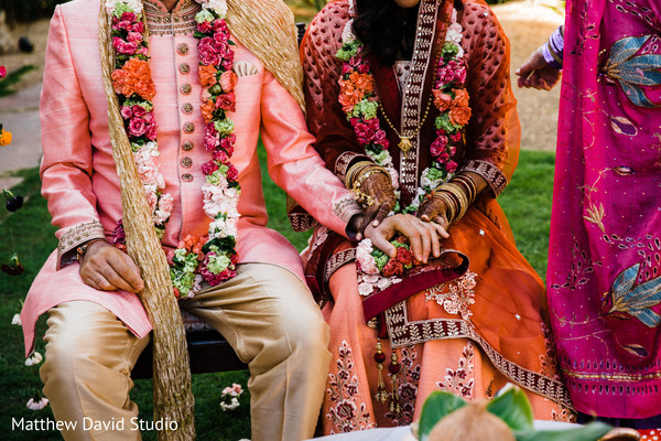Indian groom holding Maharani's hand