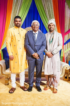 Indian groom with family members
