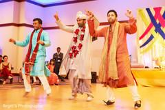 Indian groom dancing during sangeet