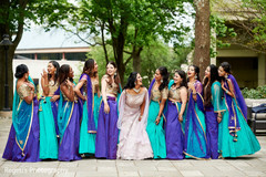 Dazzling Indian bride with bridesmaids capture.