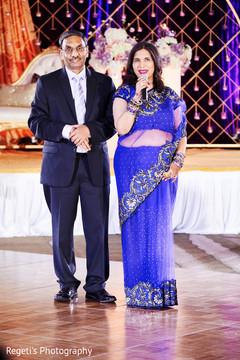 Indian relatives at reception speech moment.