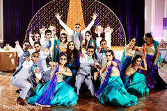 Indian bridesmaids and groomsmen wedding dance performance.