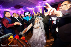 Cheerful Indian bride at  wedding reception dance.