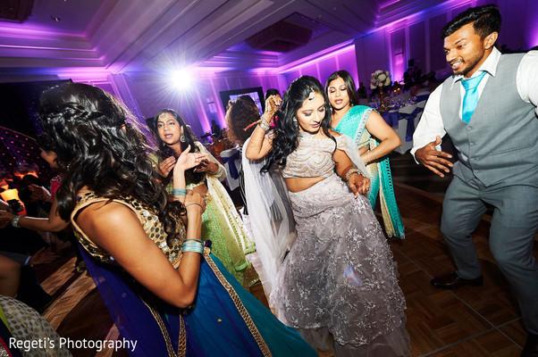Upbeat Indian bride and groomsmen dance.