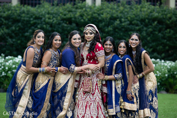 Indian bride and bridesmaids posing outdoors capture.