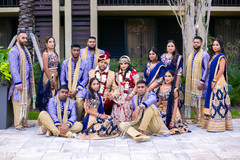 Charming Indian couple with bridesmaids and groomsmen capture.