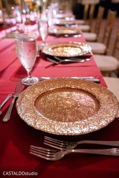 Elegant Indian wedding reception table setup.