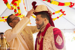 Indian groom at his wedding ceremony ritual capture.