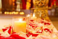 Dreamy Indian wedding ceremony aisle candle decor.