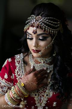 Incredible Indian bridal tikka, nose ring, choora and kundan.